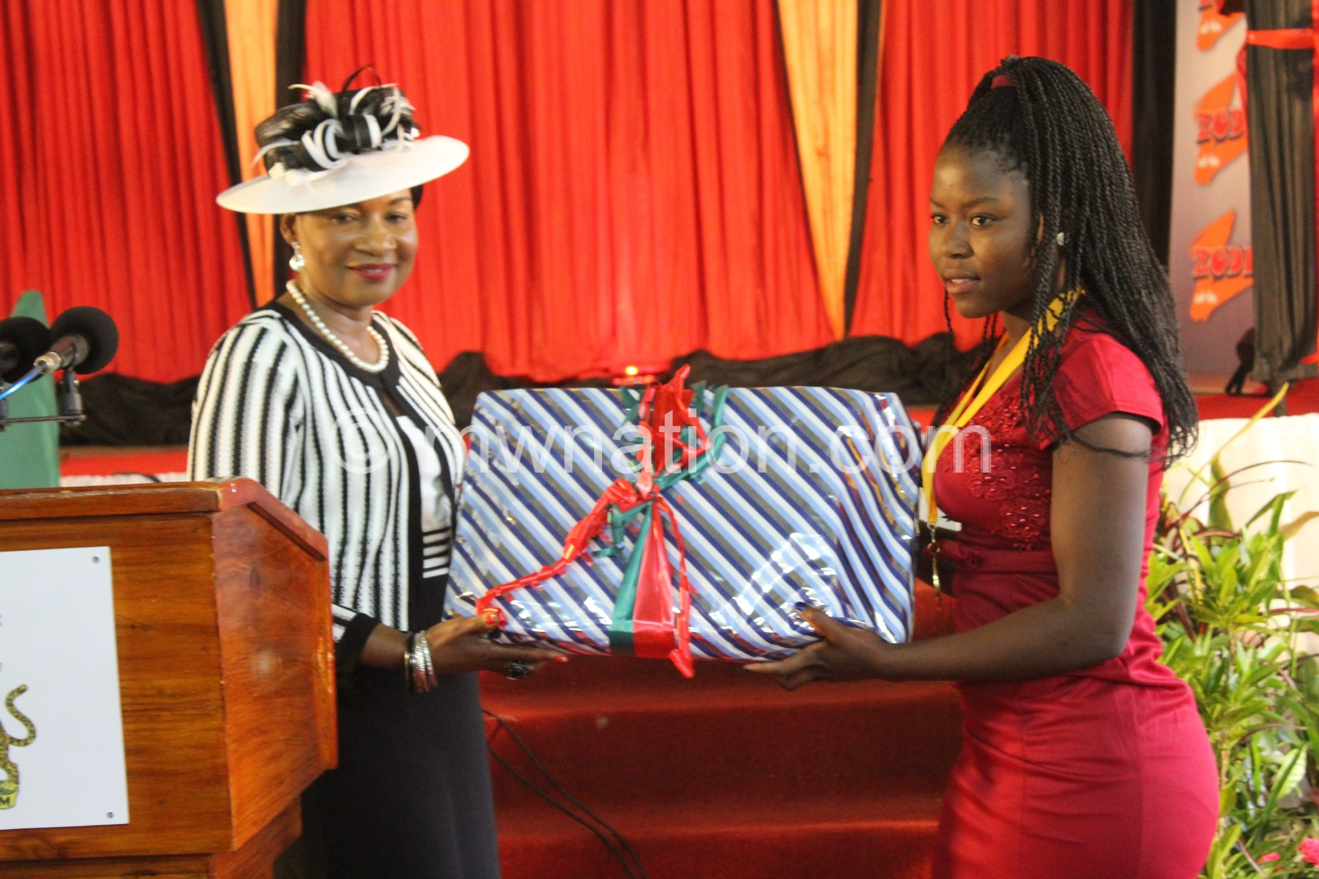 First Lady presents a lap top to Sonia Mwenda from Nkhamenya Girls Secondary School | The Nation Online