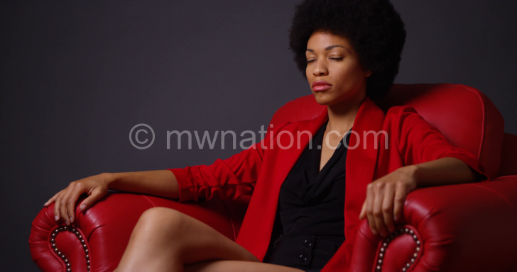 strong attractive black woman sitting in red chair eyb3disfl  F0000 e1523032923844 | The Nation Online