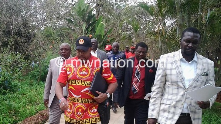 Chilima L and and his aides leave the venue after the caucus yesterday | The Nation Online