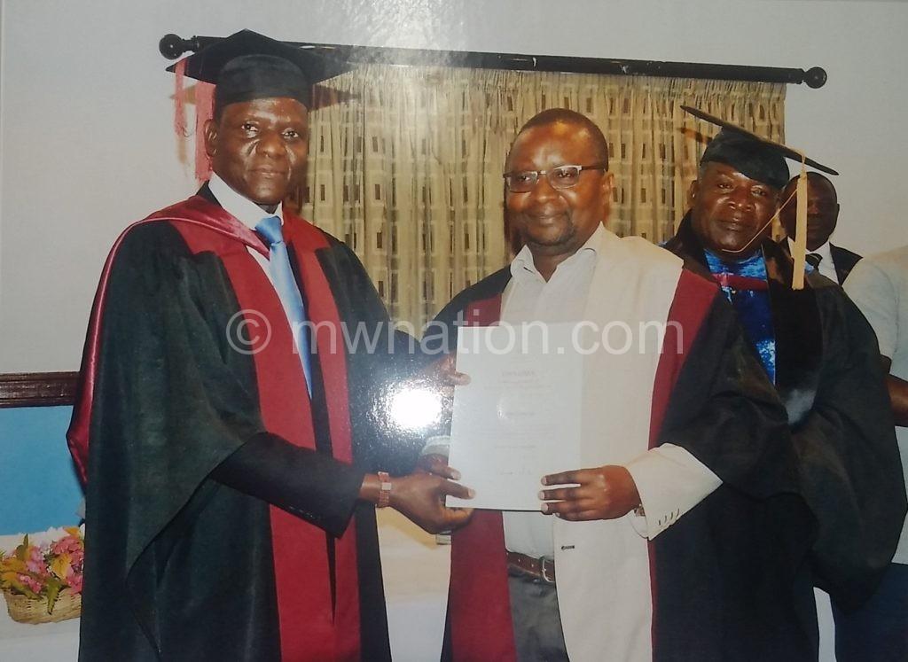 Kasaila presents a diploma to one of the graduates Kaunda   The Nation Online