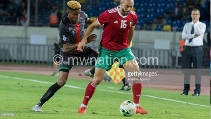 Malawi's Gerald Phiri L challenges a Morocco player   The Nation Online