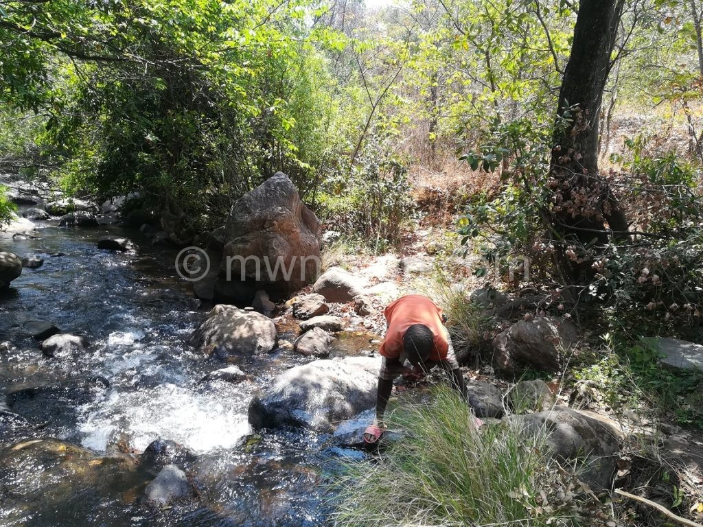 Drinking from Hewe River | The Nation Online