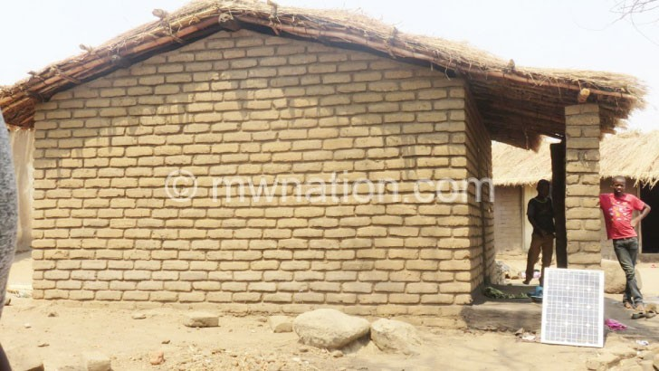 grass thatched house | The Nation Online