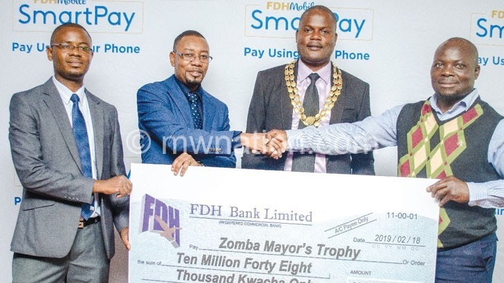 FDH Bank officials donate | The Nation Online