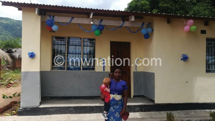 Minister hands over house to child with albinism