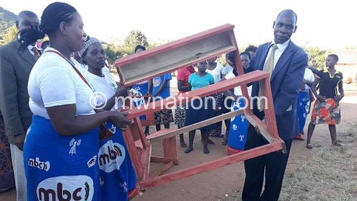 Ntchisi Zokonda Amayi group donate desks to school
