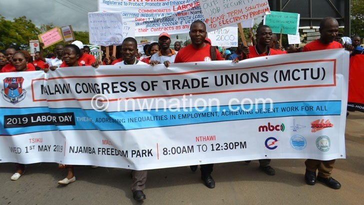 Workers spell out  grievances on May Day