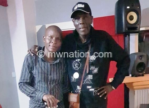 Agorosso and Mtukudzi during one of their meetings in Zimbabwe | The Nation Online