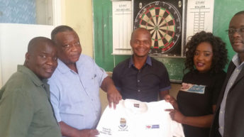 Exide donates golf shirts to Poly Darts team