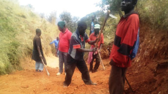 NB communities construct five km road